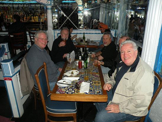 From L-R Dougie, Joebo, Swish, R. B., and Fergie seated at a table in Hella's Greek restaurant. They have the best Gyro's in Tarpon Springs.