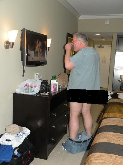 Now we are getting into photos taken later on in the trip. Here is Dougie with.....PANTS ON THE GROUND!  That is NOT a mirror that he is looking into. It's a TV! If you look to the right on the bed you can see R. B.'s tennis shoes.