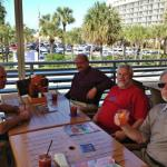 R. B., Jimbo, Spike, and S. B. sitting at our table at the Hooters in Clearwater Beach FL.