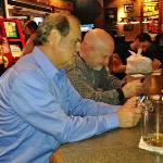 I'm glad that I took this picture  so that you can see what a fun time we have on Geezers Nite Out.  In this pic R. B. and Bubba were texting each other.