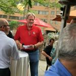 Another pic of T K O'Grady conversing with some of the crowd out on the patio.