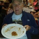 Jerry said that he didn't eat the whole thing, and was holding his plate up to the camera to prove it.  Come on Jerry, there is only one bite left, and I bet that was gone after this picture was taken!