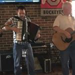 More of the band. This accordian does not have that hunkie sound. It is all IRISH!