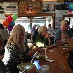 Some of the customers at the bar enjoying the festivities. Among them are Diane, Vicki, and her husband.